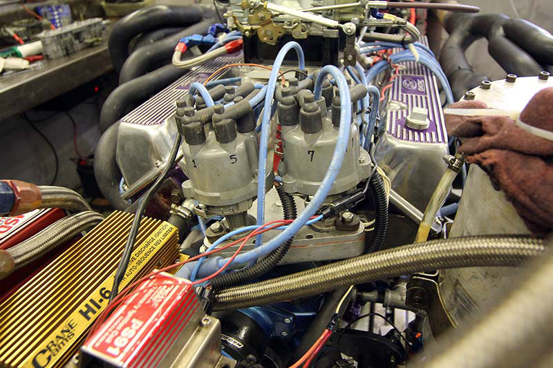 Instead of trying to draw up some V12 ignition from scratch, Baker simply built a setup to run two straight-six Ford igntitions (one for each bank of cylinders).